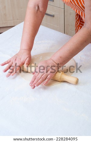 Woman hands knead dough . Cooking pizza