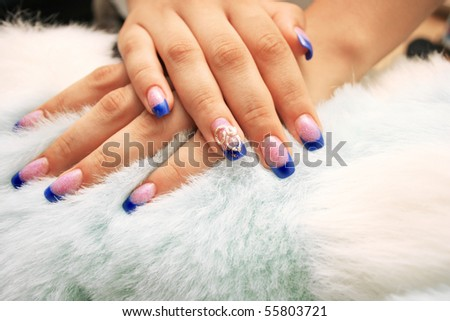 Woman hands on fur background. - stock photo