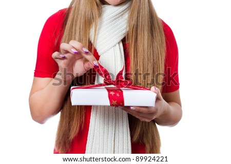 woman hands opening christmas gift - isolated - stock photo