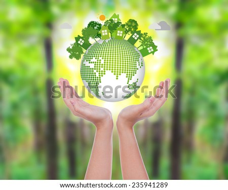 Woman hands over green forest hold eco friendly earth - stock photo