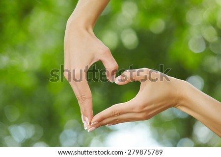 woman hands over nature background - stock photo
