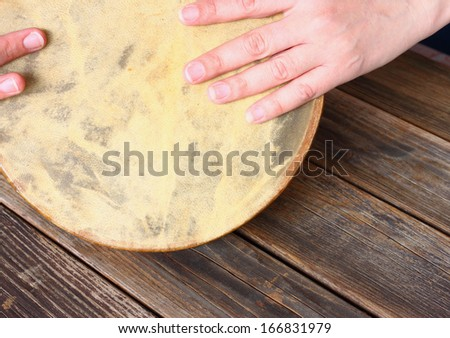 woman hands playing ethnic drum - stock photo