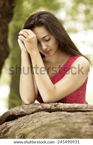 Woman hands praying in the forest. Outdoors. Nature. - stock photo