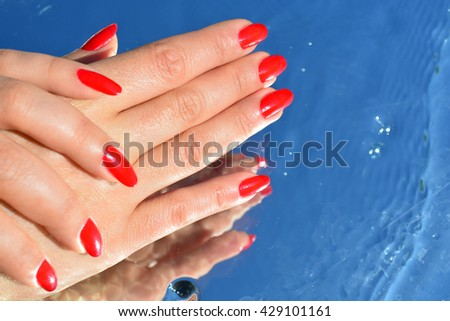 woman hands, reflection in the water