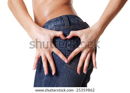 woman hands showing heart shape over blue jeans - stock photo