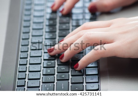 Woman hands typing on laptop keyboard close up - stock photo