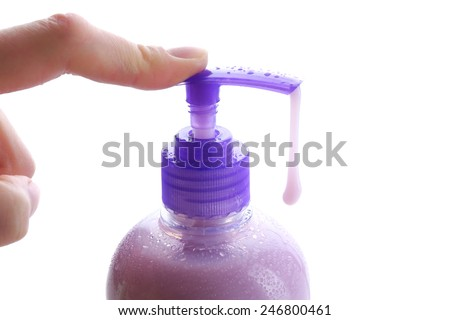 Woman hands using soap dispenser isolated on white - stock photo