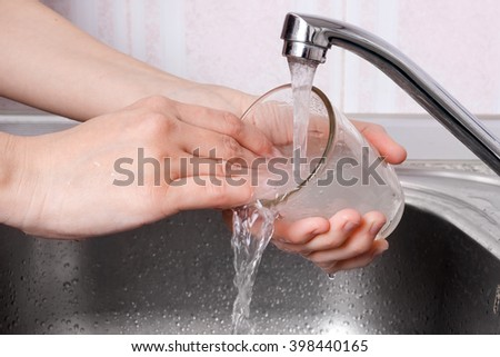 woman hands washing the glass