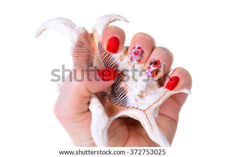 Woman hands with art modern red  manicure with sea shell  isolated on the white.