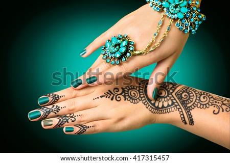 Mehndi Tattoo For Hand : Woman hands black mehndi tattoo stock photo 417315457