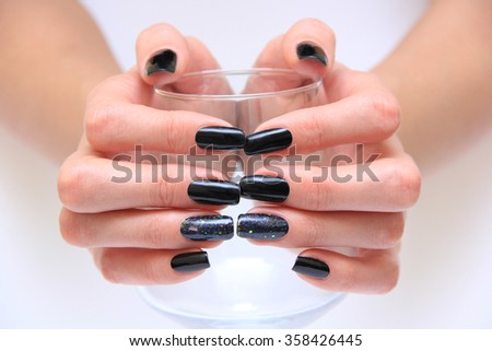 woman hands with black nails. Manicure - stock photo
