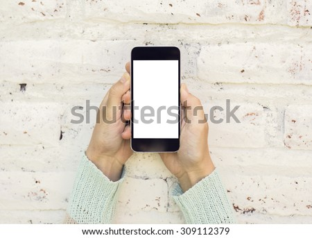 Woman hands with blank cell phone, mock up - stock photo