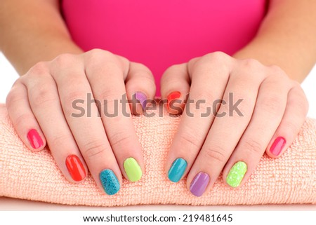 Woman hands with bright manicure, close-up - stock photo