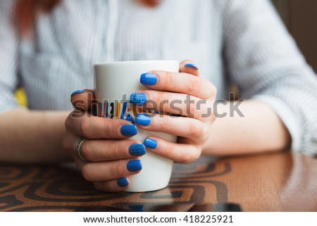 woman hands with coffe on a wood table - stock photo