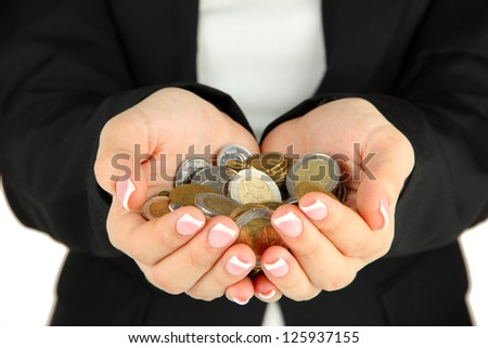 Woman hands with coins isolated on white