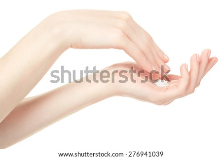 Woman hands with cream isolated on white, clipping path included - stock photo