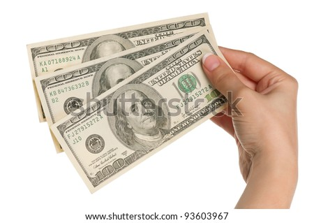 Woman hands with dollars isolated on white background - stock photo