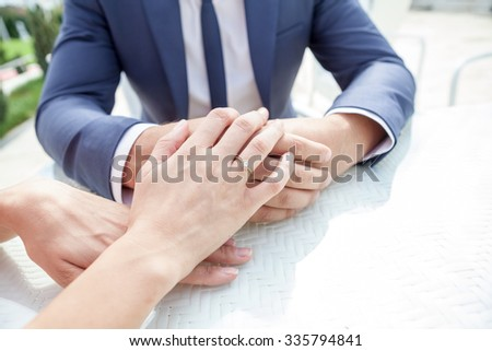 Woman hands with engagement ring - stock photo