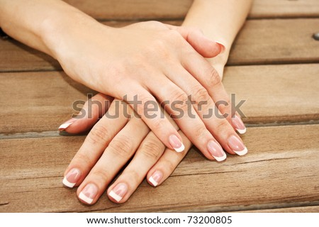 Woman hands with french manicure - stock photo