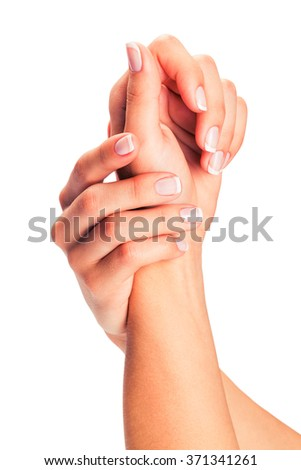 Woman hands with french manicure isolated on a white background - stock photo
