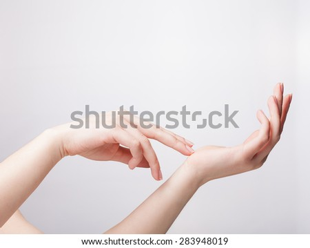 woman hands with french manicure nails isolated on a white background - stock photo