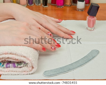 Woman hands with manicure after spa procedure - stock photo