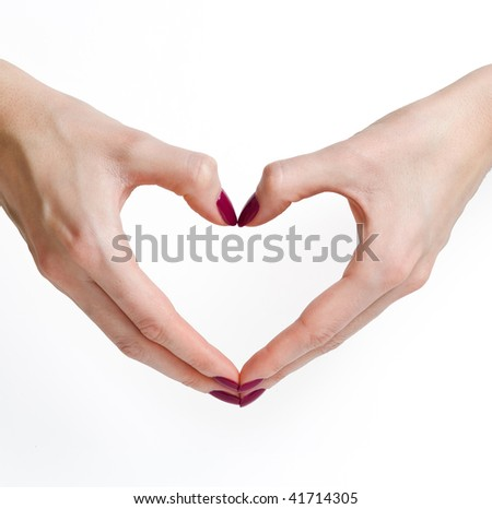 Woman hands with manicure in heart shape isolated on white