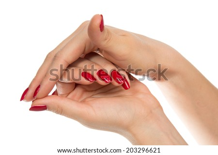 Woman hands with manicured red nails isolated on a white background. Skin and nail care concept