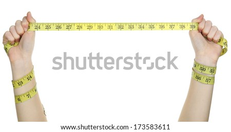 Woman hands with measuring tape isolated on white - stock photo