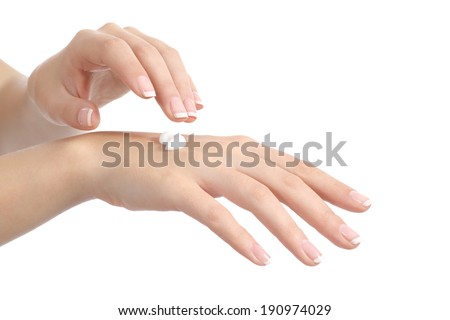 Woman hands with perfect manicure applying moisturizer cream isolated on a white background - stock photo