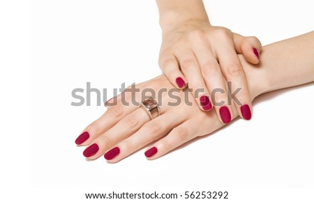 Woman hands with pink manicure and gemstone ring - stock photo