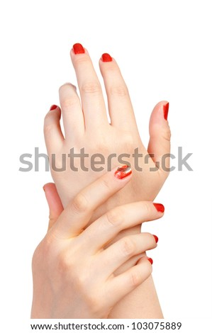 woman hands with red nails against the white background - stock photo