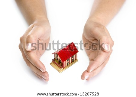 woman hands with small house - real state concept - stock photo