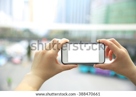 woman hands with smart phone in modern city