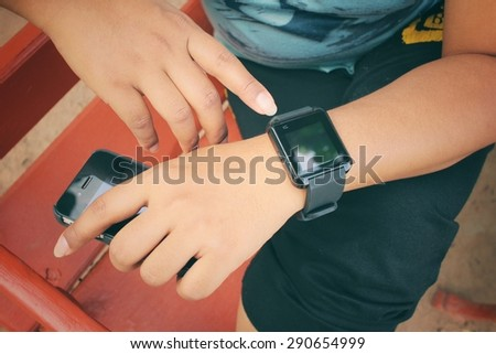 Woman hands with smartwatch