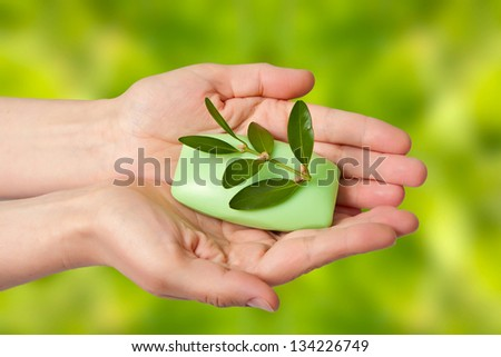Woman hands with soap and spring on abstract background - stock photo