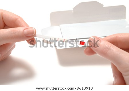 woman hands with test for pregnancy - stock photo