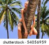 Woman hangs and relaxes to the palm tree after work in the office - stock photo