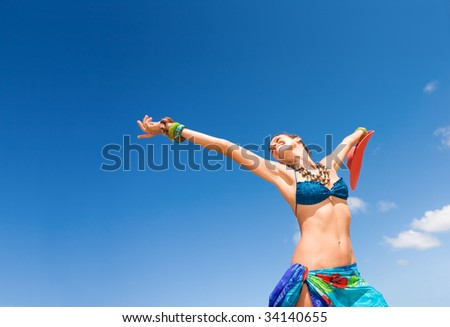 woman happy and carefree with clear blue sky