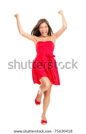 Woman happy cheering in summer dress - playful and cheerful. Isolated on white background in full length. Beautiful fresh young mixed race ethnic female model in red dress- - stock photo