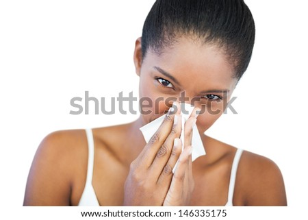 Woman has a cold on white background - stock photo