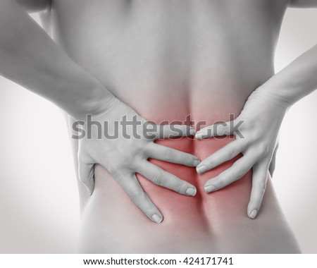 woman has backache  - stock photo