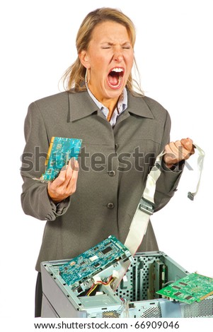 Woman has reached her end with her broken computer - stock photo