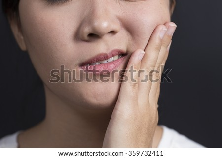Woman has Tooth Ache - stock photo