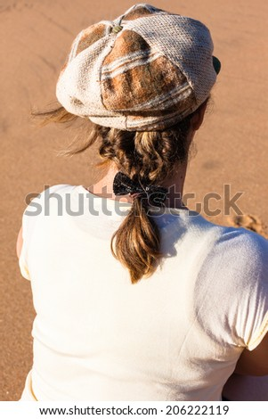 Woman Hat Hair Casual Beach Mature Woman rear portrait head hat shoulders hair plats casual style makeup looks beach outing. - stock photo