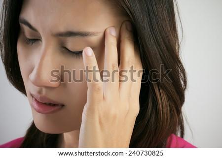 Woman have headache - stock photo