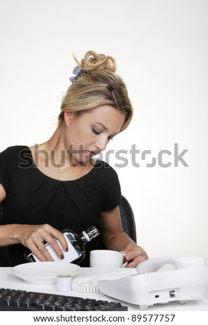 woman having a alcohol at work pouring it into her cup so no one will know