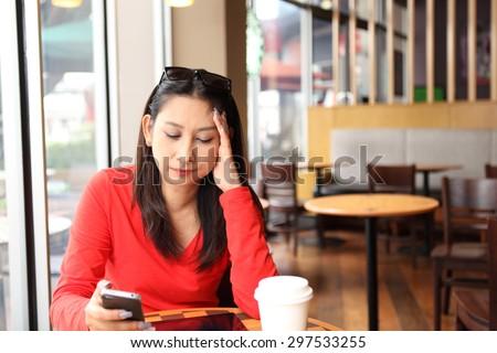 Woman having a headache - stock photo
