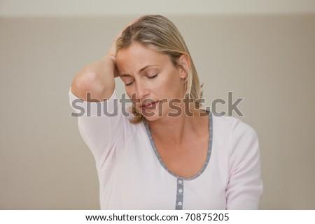 Woman having a headache at home - stock photo