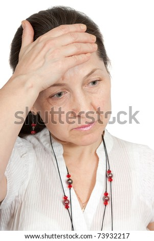 Woman having a headache holding her forehead in pain - stock photo